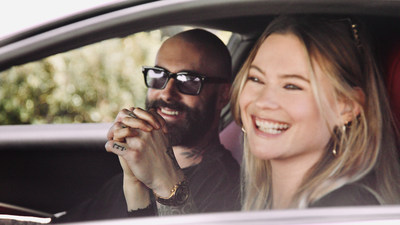 Maroon 5's Adam Levine and wife Behati Prinsloo join forces with Ferrari to benefit Save the Children. Shown here in the new Ferrari Roma.