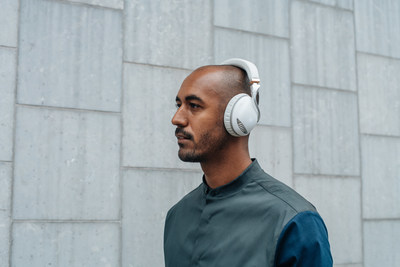 Motion Designer, Nik Hill, wears IRIS Flow Headphones in white