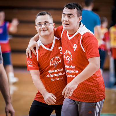 Two Special Olympics Unified basketball participants celebrate during a Special Olympics Unified Sports® event at the Romanian Basketball Federation Sports Hall in December 2018. Photo by Alina Cojocaru