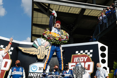 Takuma Sato celebrates his Indianapolis 500 win today in Victory Circle.