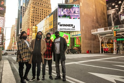 Future First Studio team with their OUTFRAME 2020 winning submission in Times Square, NYC